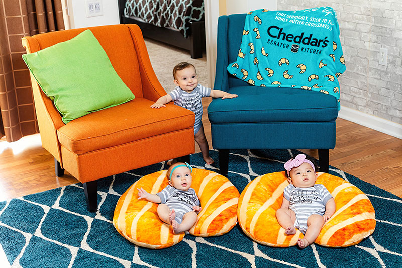 Babies will love their Cheddar's croissant-themed support pillows, onesies and baby blankets.